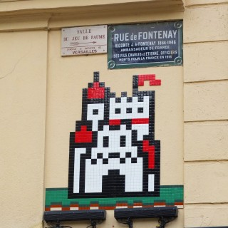 Street art invader shaped castle