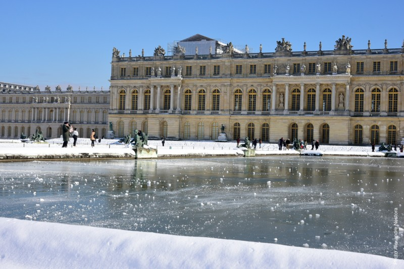View of the Palace of Versailles in winter under the snow